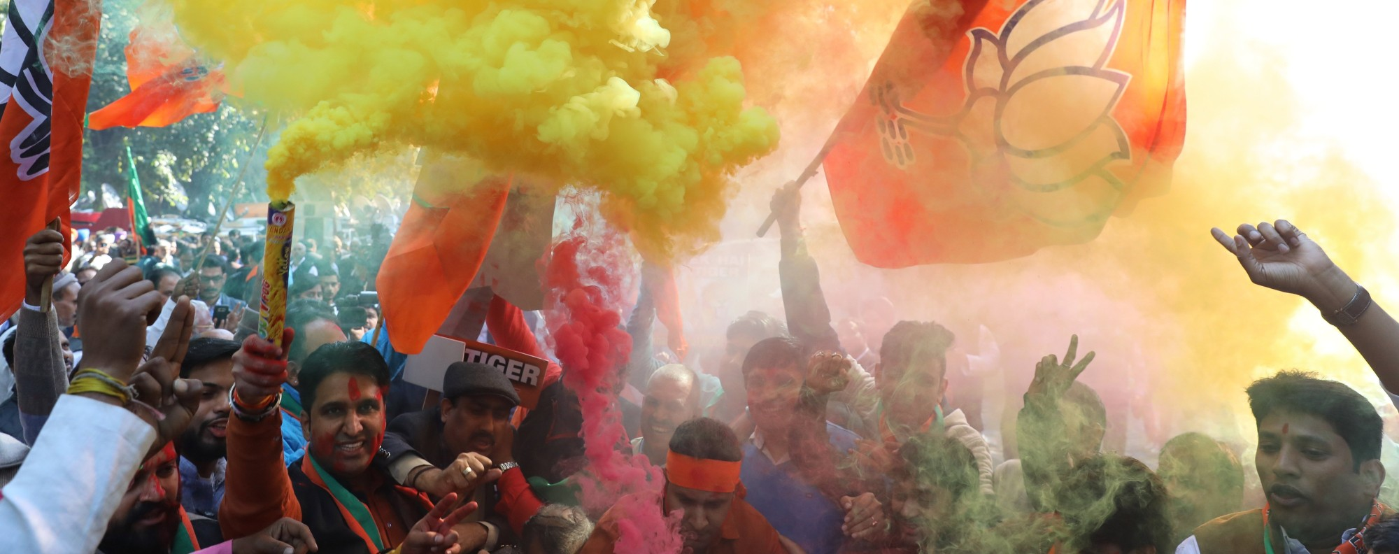 Supporters of India's Bharatiya Janta Party celebrate victory of in the Gujarat election. Photo: EPA
