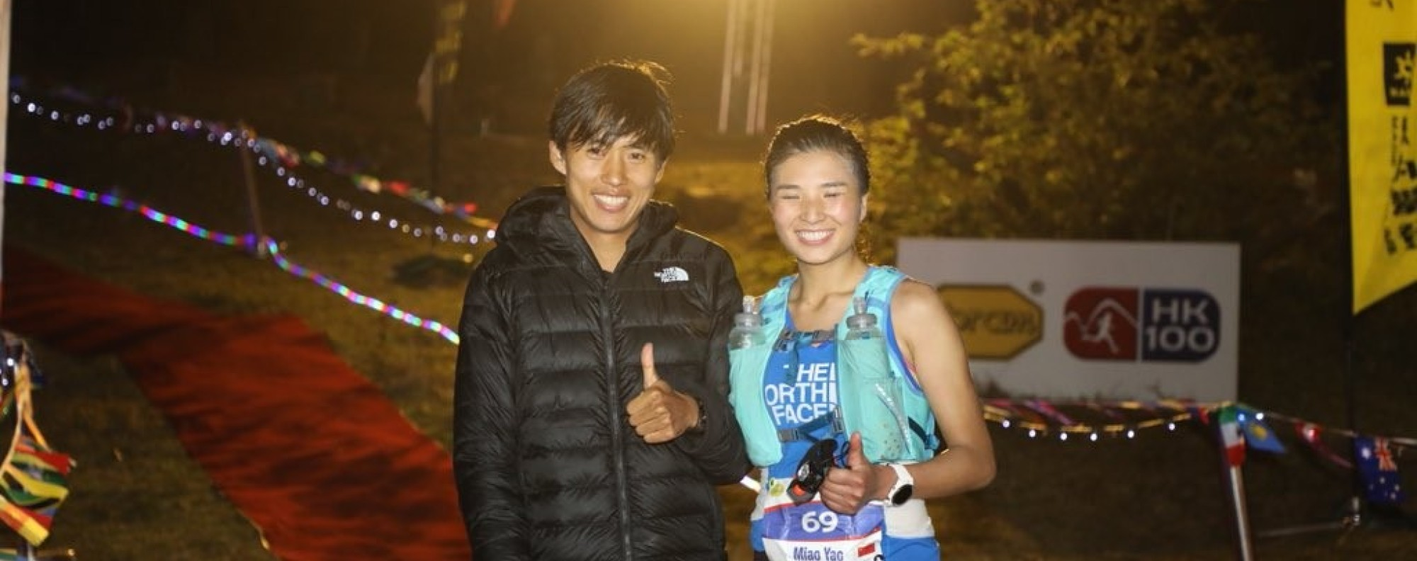 Qi Min and Yao Miao at the finish line of the HK100. Photo: Twitter/@iRunFar