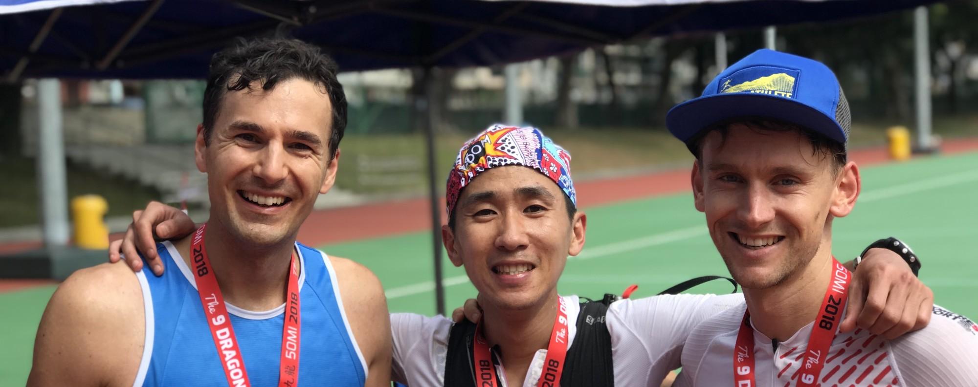 The first three runners in the men's 50-mile 9 Dragons ultra: Michael Skobierski, Deng Goumin and Harry Jones. Photo: Mark Agnew