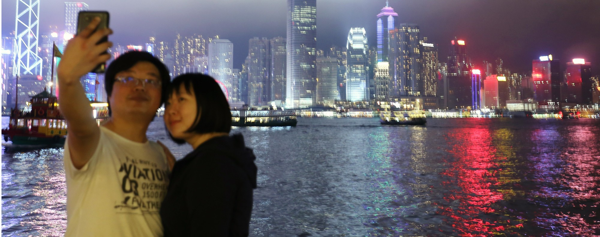 Tourists take pictures at Victoria Harbour in Tsim Sha Tsui. Photo: Dickson Lee