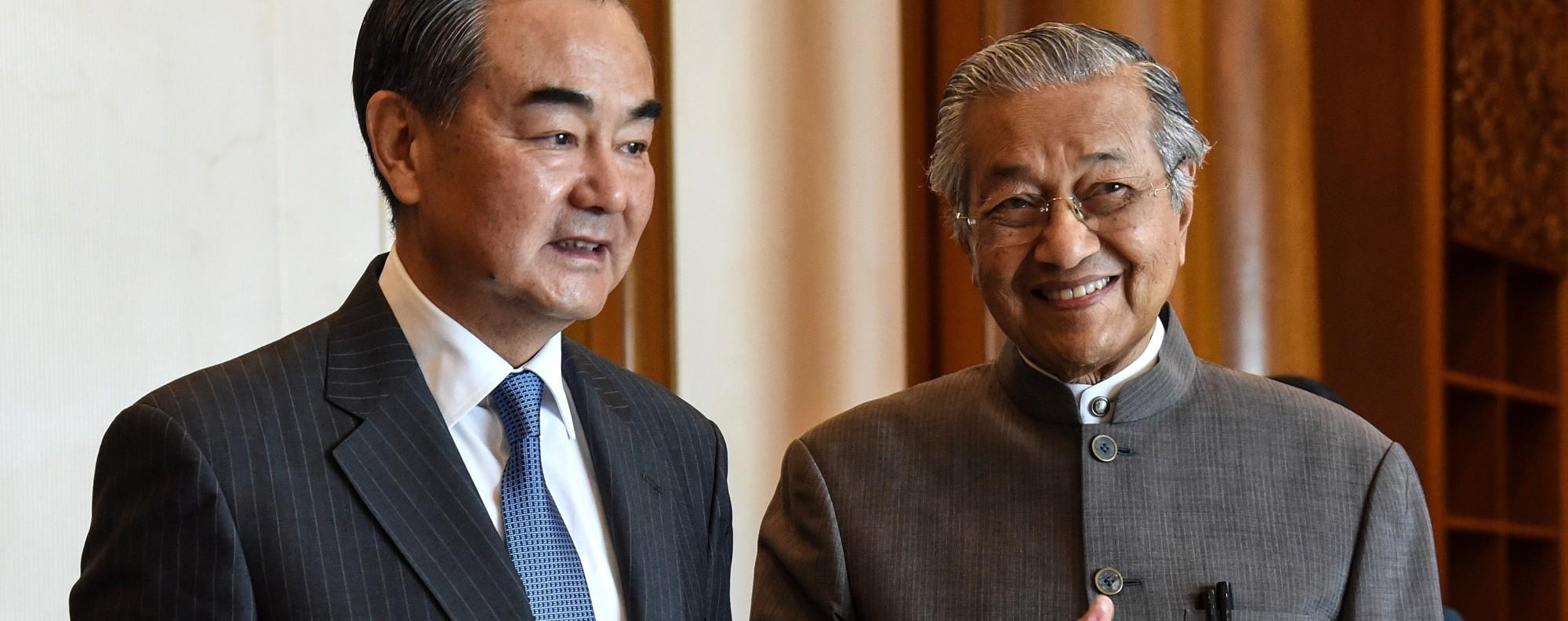 Wang Yi and Mahathir Mohamad. Photo: AFP