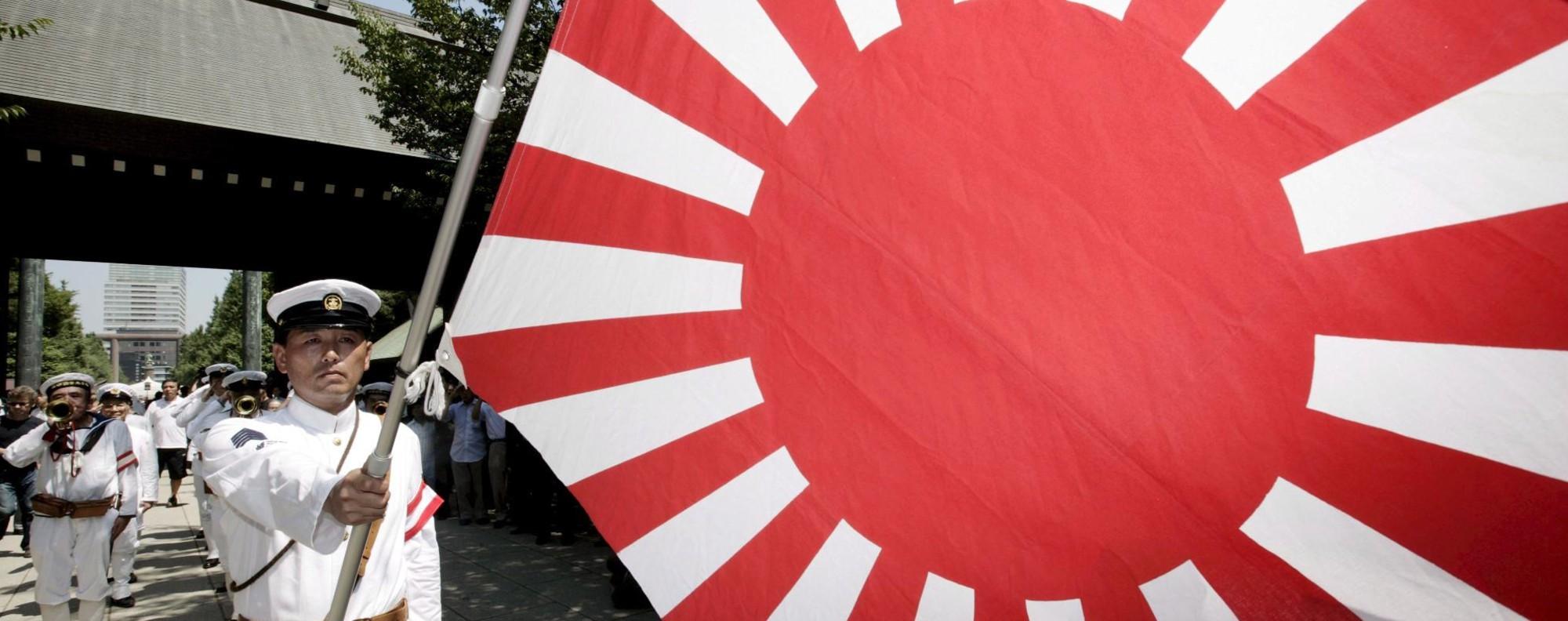 Controversial: Japan's Rising Sun flag. Photo: EPA