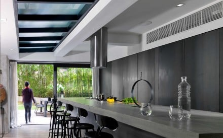 Interior designer Peggy Bels (peggybels.com) designed the kitchen, which was built for about HK$250,000 (excluding appliances). Two metal doors at the back hide the sink area. The counter stools (HK$3,000 each) came from Jerome Lepert in Paris, France (106 Rue Vieille du Temple, tel: 6 10 181 888). Oak flooring was used through much of the flat and cost HK$72 a square foot at Wonderfloor (271 Lockhart Road, Wan Chai, tel: 2728 9373), which also supplied the teak planks used outside (HK$90 a square foot). The circular sculpture is by Nathalie Decoster (www.nathaliedecoster.com).