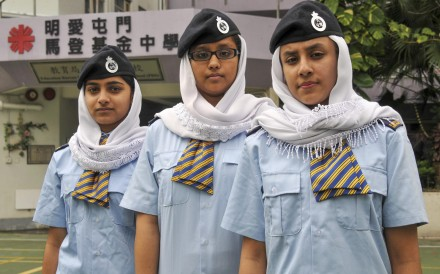 Students at Caritas Tuen Mun Marden Foundation Secondary School wear headscarves.