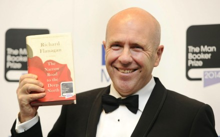 Richard Flanagan with his Booker Prize winning book. Photo: EPA