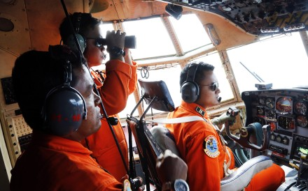 Crew of Indonesian Air Force C-130 airplane of the 31st Air Squadron scan the horizon during a search operation for the missing AirAsia flight 8501 over the waters of Karimata Strait in Indonesia. Photo: AP