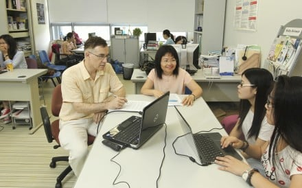 Virginia Yip and Steven Mathews assist students at the Childhood Bilingualism Research Centre at Chinese University. Photo: Franke Tsang