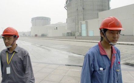 Chinese workers leave the nuclear power plant in Qinshan, in Zhejiang province, which will be inspected as part of nationwide safety checks. Photo Reuters