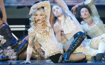 Madonna wears a Christian Lacroix outfit on stage during her Re-Invention World Tour in 2004. Photo: AFP