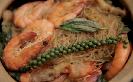 Clay pot shrimp with glass vermicelli, fresh green peppercorns and Thai basil.