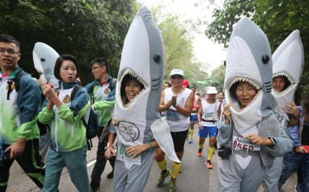 """This year's Oxfam Trailwalker is """"shark-infested"""", or so it would seem as participants gather at Pak Tam Chung in Sai Kung. Photo: Felix Wong"""