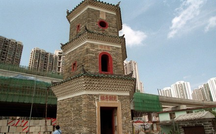 "Built in 1486, Hong Kong's sole ""ancient"" pagoda, Tsui Tsing Lau, in Ping Shan, was a rural landmark in 1979 (below) but has since been enveloped by the urban sprawl. Photo: SCMP"