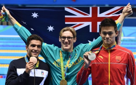 Gold medal winner Mack Horton of Australia (centre) poses for photographers with silver winner Sun Yang of China (right) and bronze winner Gabriele Detti of Italy after the men's 400m freestyle final on Saturday. Photos: EPA