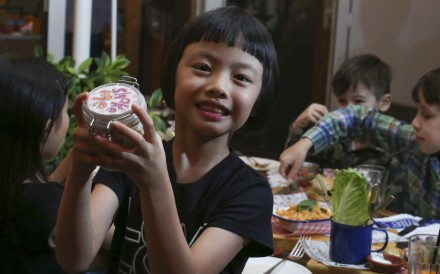 This image shows Hava Lee, 7 shaking a salad during a children's food review at Jamie's Italian in Tsim Sha Tsui. 30NOV15 SCMP/NORA TAM [FEATURES]
