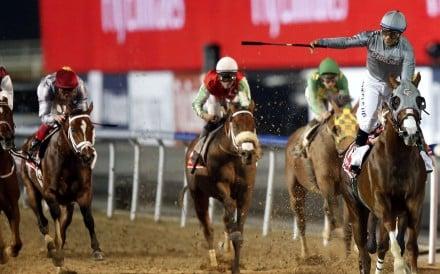 Jockey Victor Espinoza (right), on California Chrome, celebrates after winning the US$10 million Dubai World Cup at the Meydan track last night. Photo: EPA