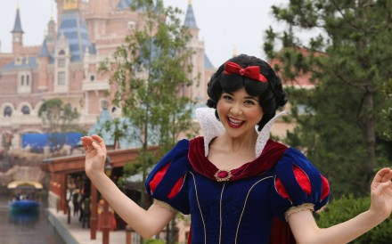 Snow White greets visitors on opening day at Shanghai Disneyland. Photo: Xinhua