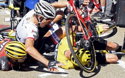 Chris Froome hits the ground in his yellow jersey. Photo: Reuters