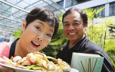 Cookbook authors Chan Kei-lum and Diora Fong with one of their dishes: pomfret with crispy bones. Photo: May Tse