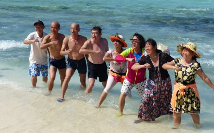 Chinese tourists sing and dance to patriotic songs on Silver Islet in the Paracel Islands. Photo: SCMP Pictures