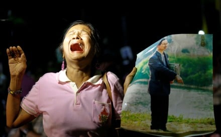 A woman weeps after an announcement that Thailand's King Bhumibol Adulyadej has died. Photo: Reuters