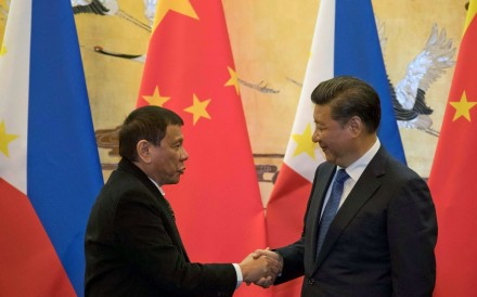 Philippine President Rodrigo Duterte and Chinese President Xi Jinping shake hands after a signing ceremony in Beijing. Photo: Reuters