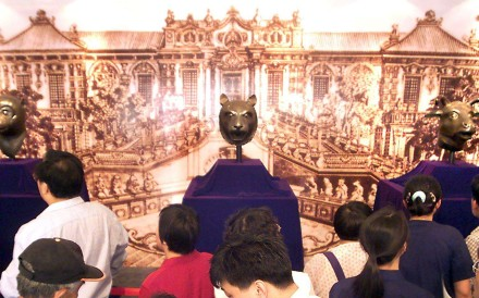 Three bronze heads, of a monkey, a tiger and an ox, are display at a private museum in Beijing in May 2000 after they were bought by a mainland company at an auction in Hong Kong. Considered national treasures from the old Summer Palace, the looted relics sparked an outcry from Chinese media, scholars and politicians when they were put up for sale. Photo: AFP