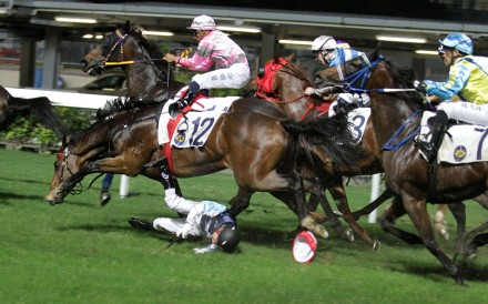 Matthew Chadwick hits the turf at Happy Valley on Wednesday night. Photos: Kenneth Chan