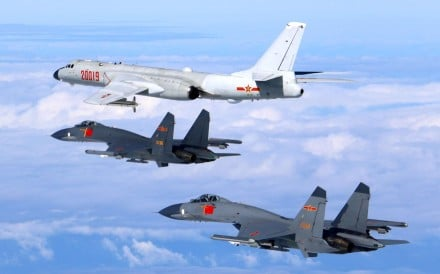Pictures released by the Chinese air force on Sunday show a PLA H-6K bomber and two J-11 fighter jets on an unspecified training mission. Photo: Xinhua