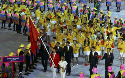 Flagbearer Sheng Lei of China leads his contingent during the opening ceremony in Rio de Janeiro. Photo: Reuters