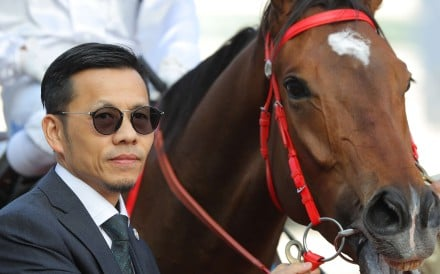 Frankie Lor poses with one of John Size's winners this season. The 51-year-old has served as Size's assistant trainer for the past four seasons. Photos: Kenneth Chan.