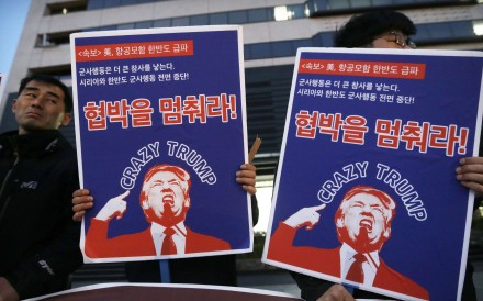 South Korean protesters hold images of US President Donald Trump during a rally denouncing the United States' policy against North Korea near the US. Embassy in Seoul on Wednesday. Photo: AP