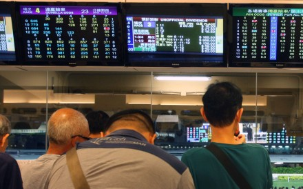 Punters betting at Happy Valley racecourse. Photos: Kenneth Chan