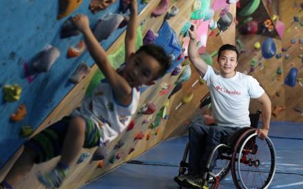 Rock climber Lai Chi-wai with his son Gordon at San Po Kong indoor gym Just Climb. Photo: Nora Tam