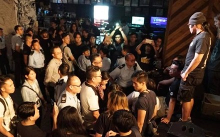 The scene at Hong Kong indie music venue Hidden Agenda in Kwun Tong as police and immigration officers conduct a raid on Sunday. Photo: Facebook