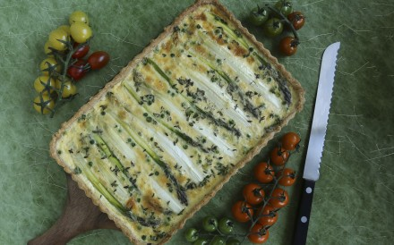 A delicate savoury tart with a cheesy crust, green and white asparagus and garlic cream