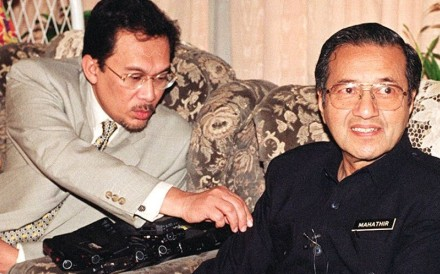 Anwar Ibrahim, then deputy prime minister (right), with prime minister Mahathir Mohamad in 1997. Photo: AFP