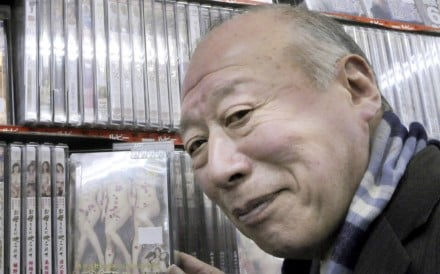 Eighty-two-year-old porn video actor Shigeo Tokuda visits a Tokyo video shop. Tokuda might look like an average Japanese grandfather but appearances can be deceiving. He is the country's king of elderly porn, a fast-growing niche market in this greying society. Photo: AFP