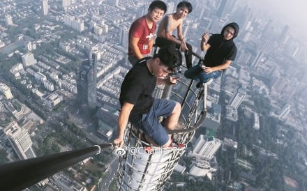 Members of the group at the top of the Zifeng tower in Nanjing. Photo: Handout