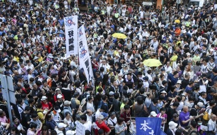 Crowds march from Wan Chai to Central in protest against the jailing of activists. Photo: David Wong