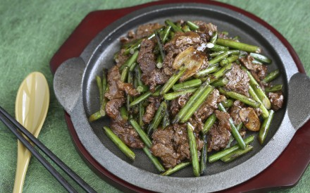 Stir-fried beef and garlic scapes. Photography: Jonathan Wong. Styling: Nellie Ming Lee