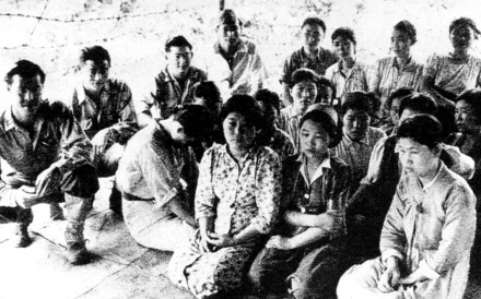 "Young Chinese ""comfort women"" are pictured sitting with Japanese soldiers during the second world war. It is not known what year this image was taken."