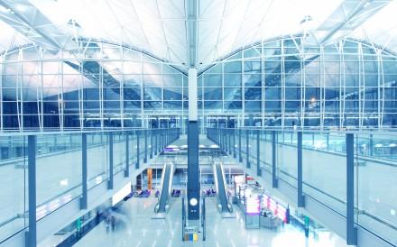 Virginal white walkways at Hong Kong airport.