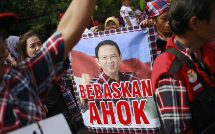 Supporters of former Jakarta governor Basuki Tjahaja Purnama, aka Ahok, call for his release during a rally in Jakarta, on May 9, the day an Indonesian court sentenced him to two years in prison for blasphemy. Picture: AP