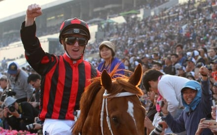 Zac Purton celebrates winning the Hong Kong Cup aboard Time Warp. Photos: Kenneth Chan