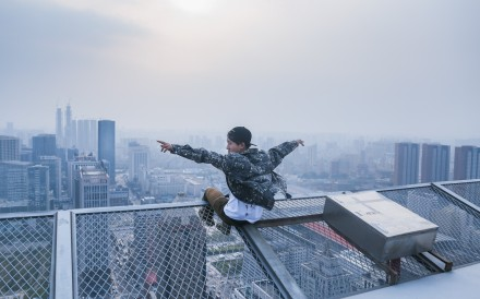 Tong Shenglin takes in life at the top of a building in Shenyang, Liaoning province. Photo: Tong Shenglin