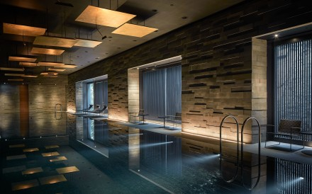 Interior designer Koichiro Ikebuchi designed a swimming pool inspired by Japan's onsen for the clubhouse of the Pavilia Hill residential development in Tin Hau, Hong Kong.