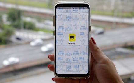 The 99 app. The acquisition intensifies Didi's global rivalry with Uber. Photo: Reuters