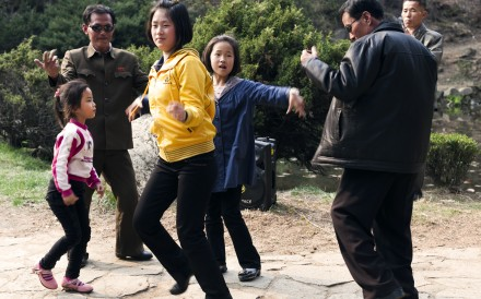 A family dances to music in Moranbong park, a popular spot in central Pyongyang. Locals gather here for barbecues and picnics and it is a favoured backdrop for wedding photos. Locals are thrilled when foreign visitors join in with the dancing.