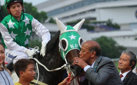 Kerm Din kisses Pakistan Star after Matthew Chadwick's second win on the horse as trainer Tony Cruz looks on. Photos: Kenneth Chan.