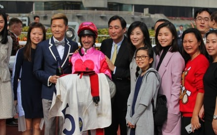 Owner Edmond So (wearing the bow-tie), jockey Olivier Doleuze and trainer Michael Chang celebrate Marqula's victory. Photo: Kenneth Chan